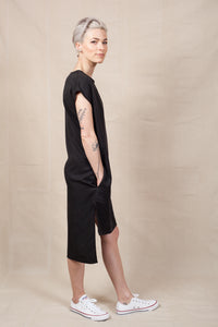 side image of black shift dress with side slits and pockets