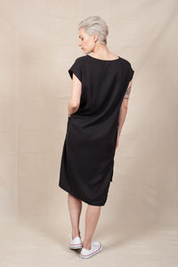 back image of black shift dress with side slits and pockets