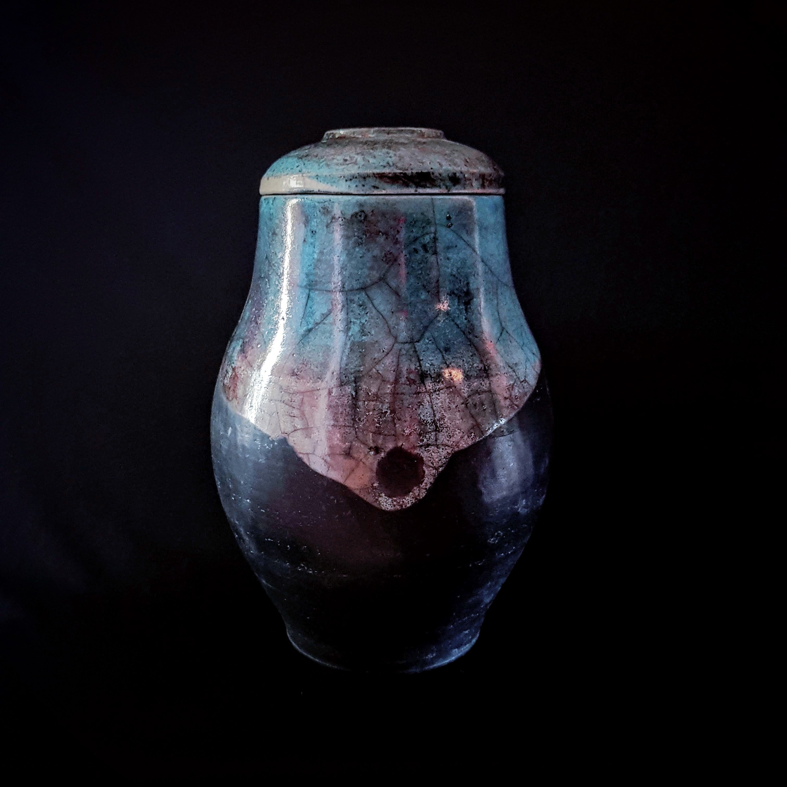 Shine black Cremation Urn, Hand Crafted unique Urn by Naiim pottery.