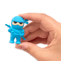 Hand holding up blue Ninja Eraser