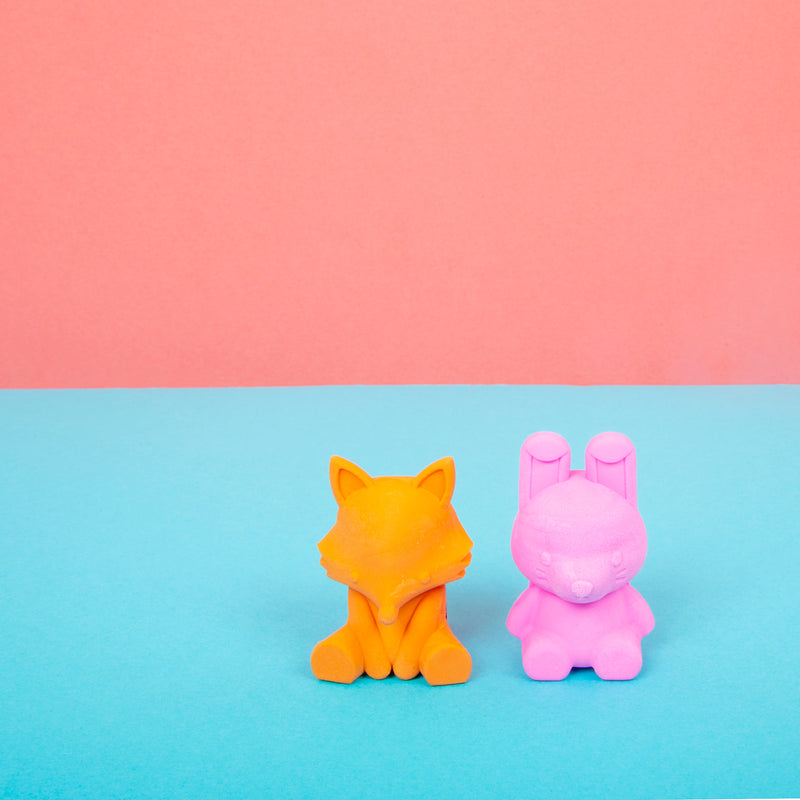 Woodland Writing Pals Erasers next to each other on blue and peach background