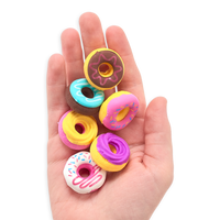 Hand holding all Dainty Donuts Erasers