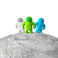 3 Astronaut Erasers shown standing on a planet top edge