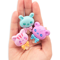 Hand holding all three Cutie Pops erasers in its palm