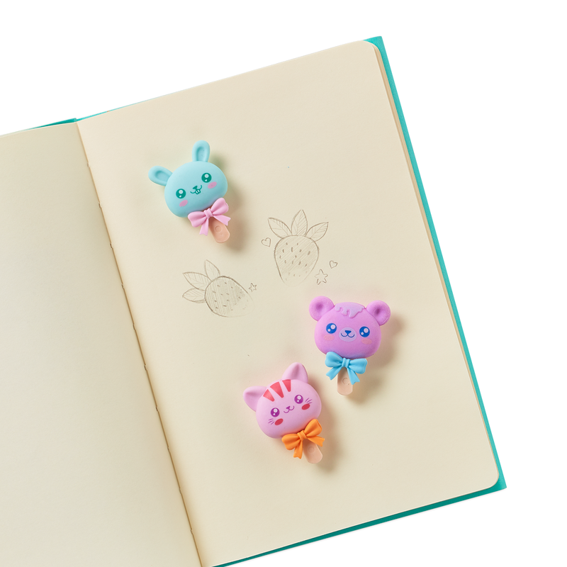 Cutie Pop strawberry scented erasers in a notebook