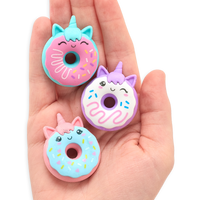 Hand holding all three Magic Bakery Unicorn Donut Erasers in its palm