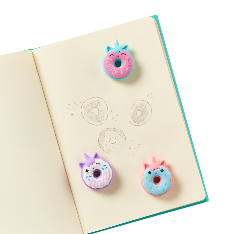Magic Bakery Unicorn Donut Scented Erasers on a journal