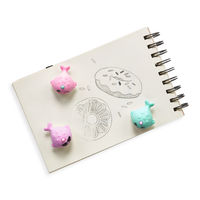 Nom Nom Narwhals Scented Erasers on a sketch of donuts