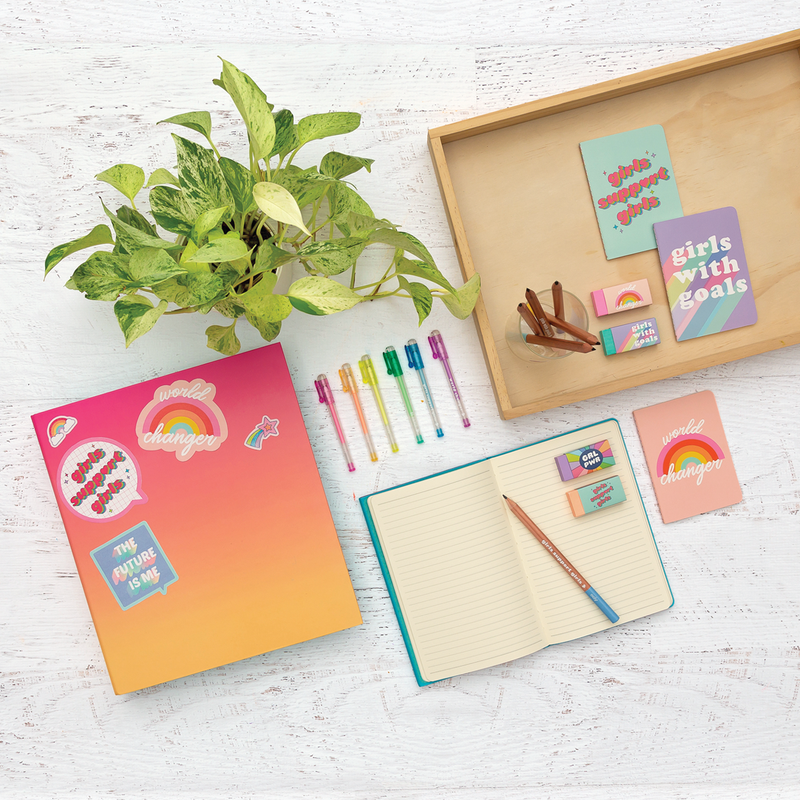 GRL PWR Pocket Pal Journals with GRL PWR gel pens, stickers and eraser in desk setting
