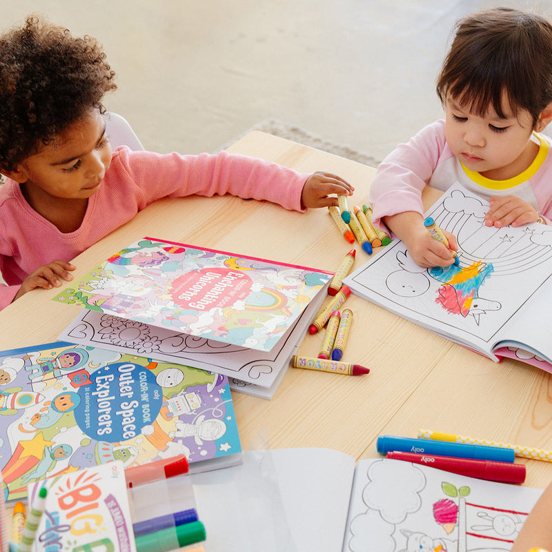 2 kids coloring in an Enchanting Unicorns Coloring Book