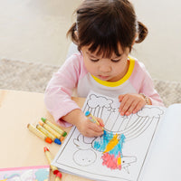 child coloring in an Enchanting Unicorns Coloring Book