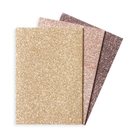 Oh My Glitter notebooks in three different gold glitter covers