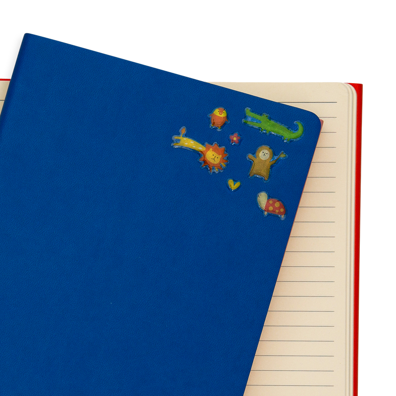 Itsy Bitsy - Wacky Wildlife mini stickers on a blue notebook.