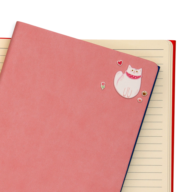 Itsy Bitsy - Puffy Pets mini stickers on a salmon colored notebook.