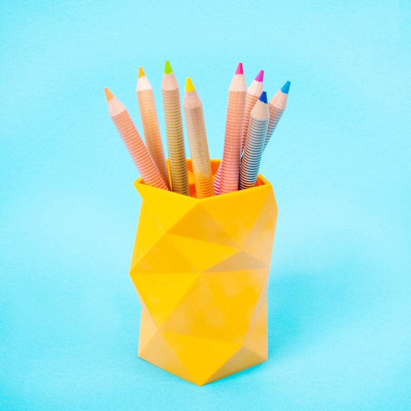 Jumbo Brights Neon Colored Pencils in a yellow cup on a teal background