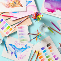Chroma Blends Mechanical Watercolor Pencils shown on table with examples of artwork made with them