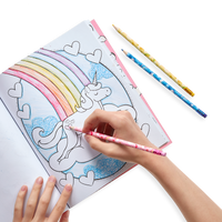 Lifestyle of girl coloring a unicorn sketchbook with Unique Unicorns Erasable Colored Pencils - Set of 12