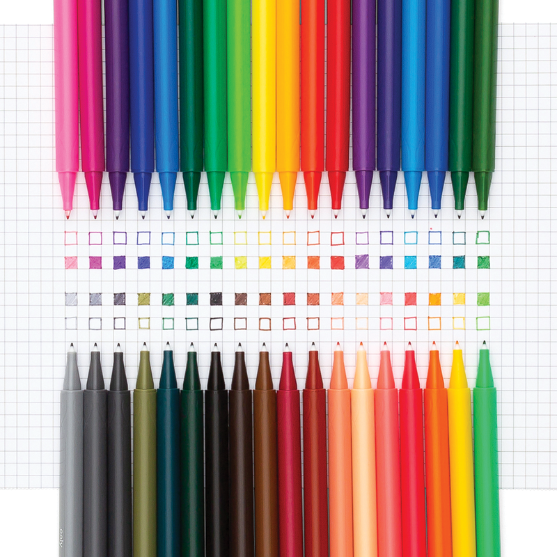 Seriously fine markers, with caps off, laid out on graph paper showing vibrant swatched colors
