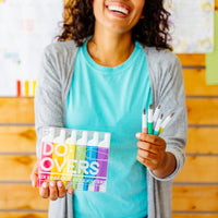 Image of happy teacher holding up Do-Overs Erasable Highlighters