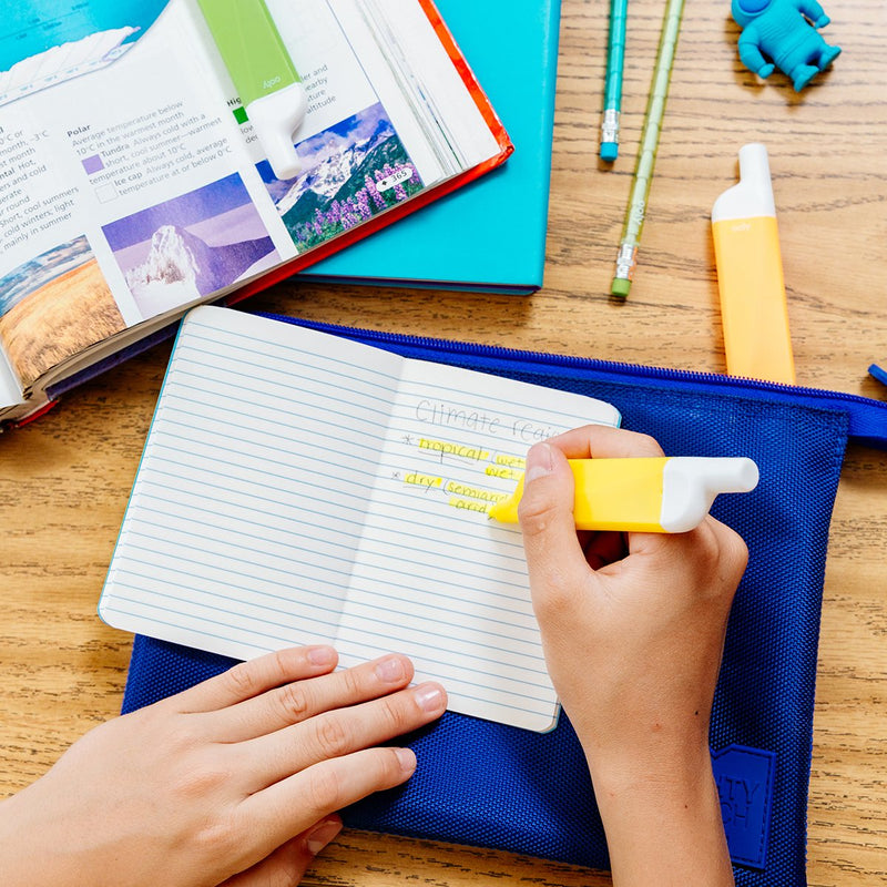 Image of kid's hands highlighting notes with yellow Do-Overs Highlighter