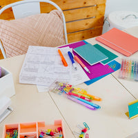 Image of teacher's desk with Mini Magic Liner Highlighters on it