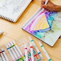 Image of a girl drawing colorful mountains using the Drawing Duet Double Ended Markers