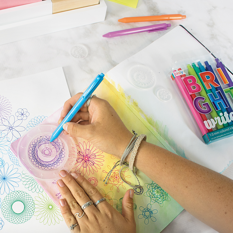 Girl drawing spirographs with Bright Writers colored ink pens