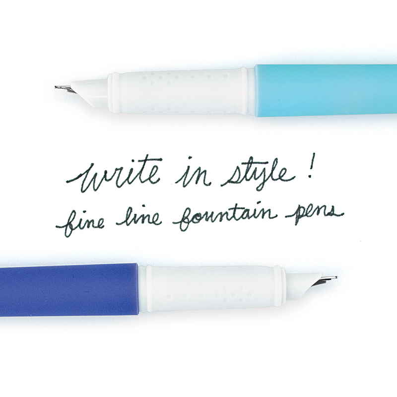"Light blue and dark blue fab fountain pens with ""write in style! fine line fountain pens"" written between them in black ink"