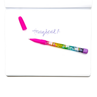 Pink Rainbow Glitter Wand Ballpoint Pen shown with writing in notebook