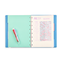 Display image of Color Click Mini 6 in 1 Ballpoint Pen writing in a journal