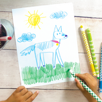 Kid drawing with Color Appeel peelable crayons sticks