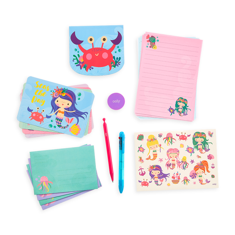 21 pieces of stationery in the Magical Mermaids On-The-Go Stationery Kit. Letter sheets, envelopes, a notebook, mechanical pencil and more
