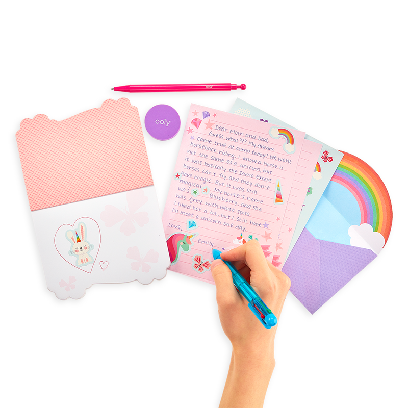 Hand writing with Unique Unicorns On-The-Go Stationery Kit note pads, post cards, letterheads and more