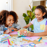 Girls playing with their On-The-Go Travel Stationery Kit - Funtastic Friends