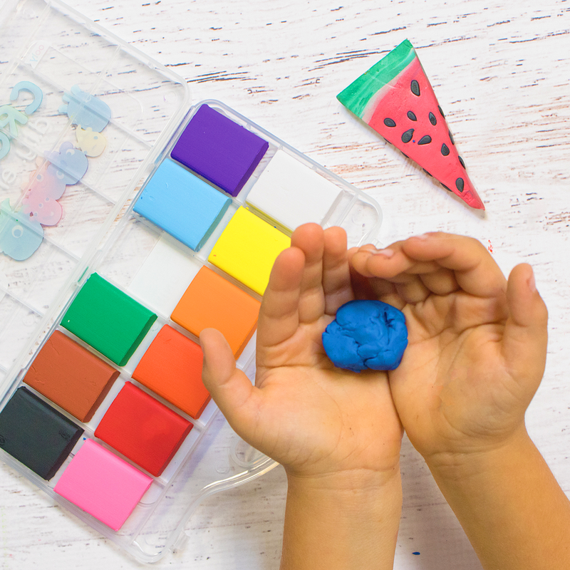 Kid holding blue Creatibles DIY eraser clay