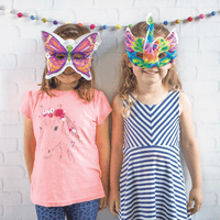 Girls wearing 3D Colorables Masks
