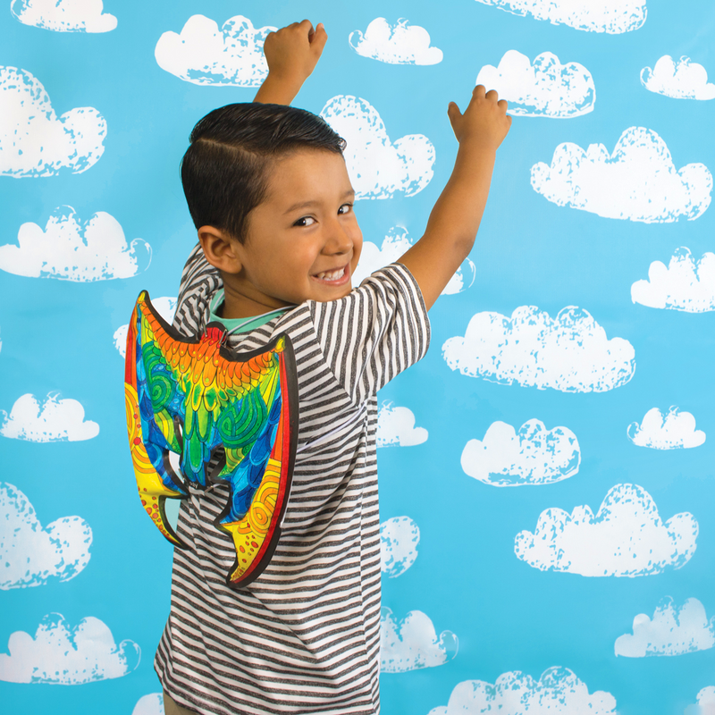 Boy playing with 3D Colorables wearable Dragon Wings with cloud background