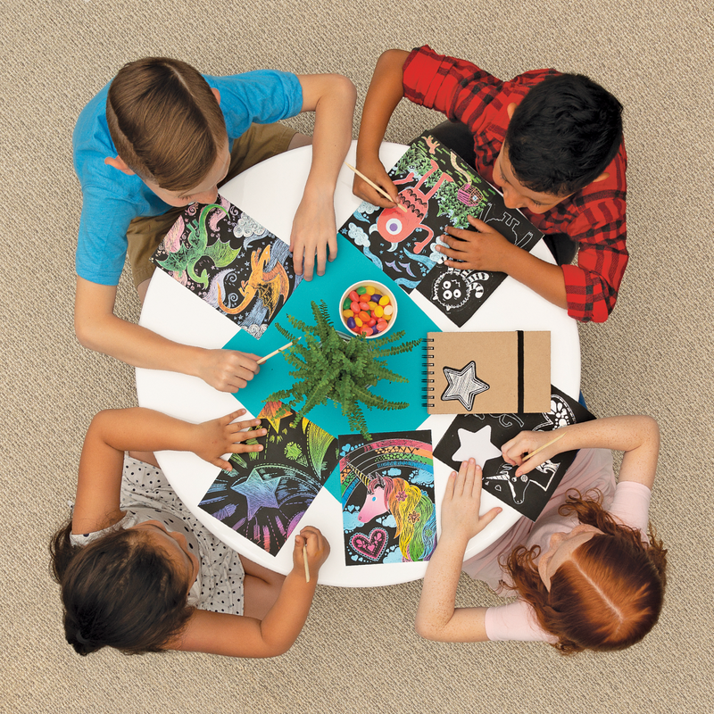 Group of kids at a table with Scratch and Scribble scratch art kits