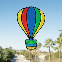 Colorful hot air balloon window cling on a window made from Creatibles DIY Window Cling art kit