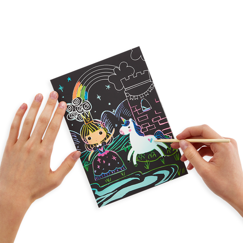 Girl using Princess Garden Scratch and Scribble scratch art kit