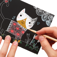 Hands scratching cat artwork of the OOLY Cutie Cats Scratch and Scribble Mini Scratch Art Kit