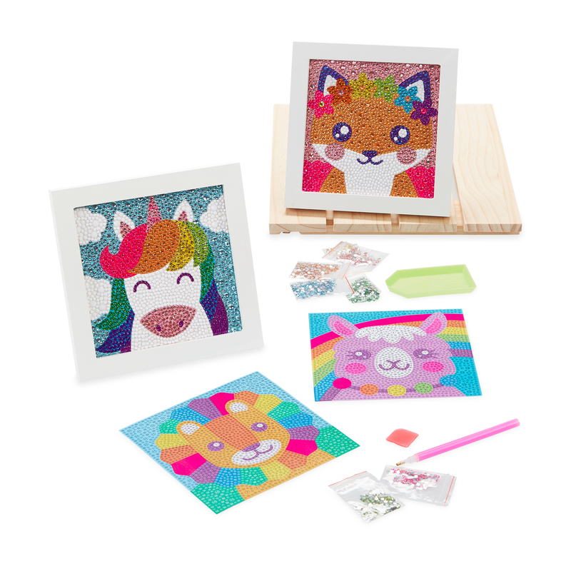 Desk setting of OOLY Razzle Dazzle DIY Gem Art Kit including Unique Unicorn, Friendly Fox, Lovely Lama, Lil' Lion.
