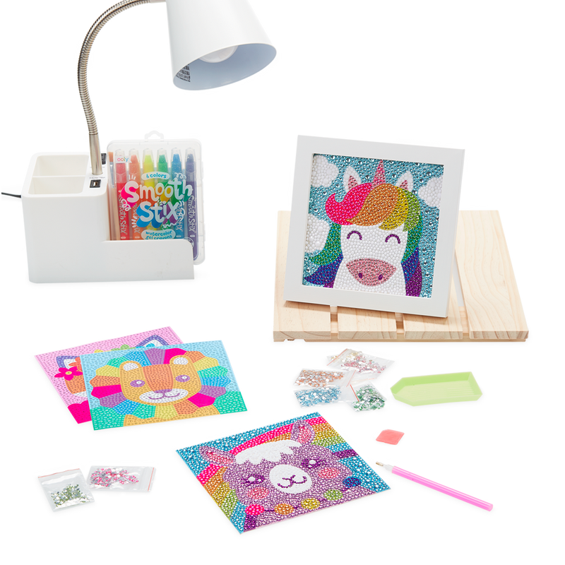 Display image of Razzle Dazzle DIY Gem Art Kit on desk setting with complete Unique Unicorns in frame.