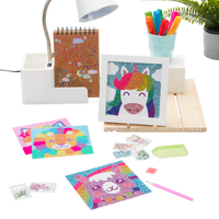 Display image of Razzle Dazzle DIY Gem Art Kits in a desk setting, includes Unique Unicorn, Lovely Lama, Friendly Fox and Lil' Lion.