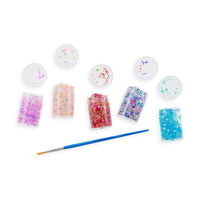 Display Image of OOLY Mini Dots Pixie Paste Glitter Glue with lids off and a paint brush