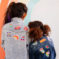Two girls with OOLY Patch 'em patches on denim jackets