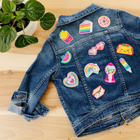 Jean jacket with various Patch 'em patches on it.