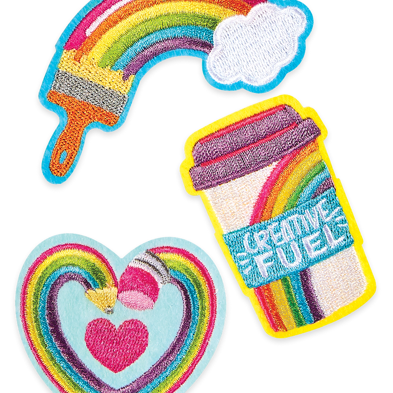 3 colorful iron on patches from OOLY featuring creative fuel and rainbows
