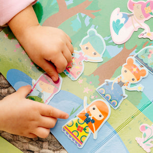 Play Again! Reusable Sticker Scenes - Princess Garden showing kids hands with the stickers and game board