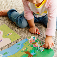 Child playing with the stickers ofCastle backdrop for the Play Again! Reusable Sticker Scenes - Princess Garden